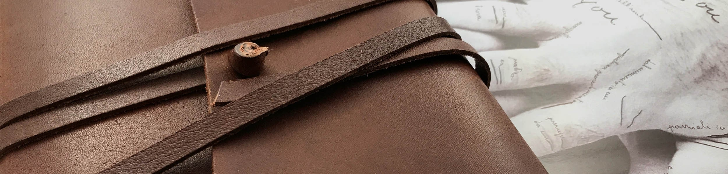 Handmade leather journals, photo albums and writing accessories.